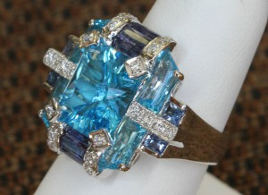 Side View of Radiant Cut Blue Topaz, Sapphire and Diamond Ring